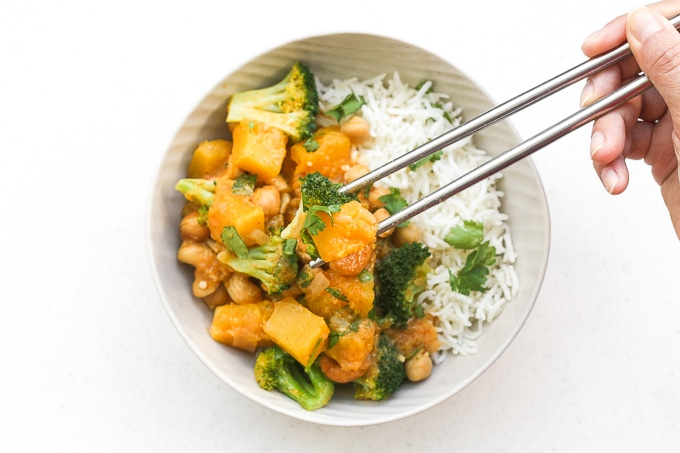Warm yourself up this fall with a big bowl of comforting pumpkin chickpea coconut curry with cashews. This curry is also vegan and gluten-free! | aheadofthyme.com