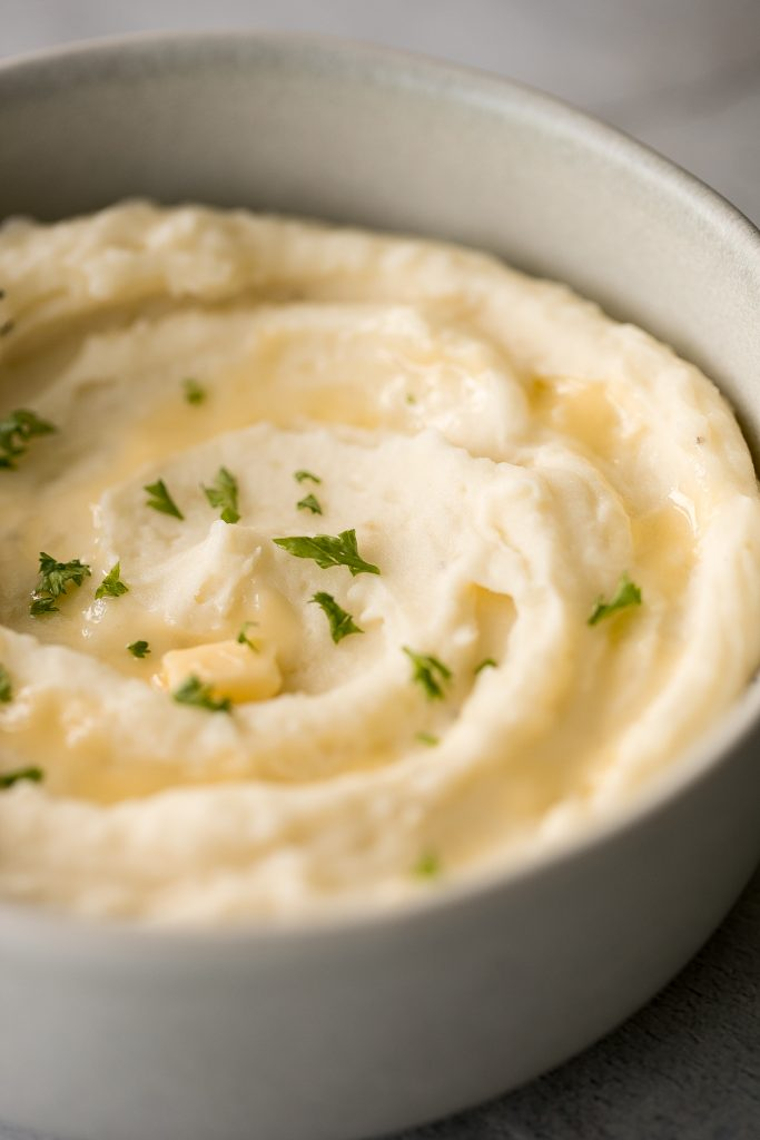 Creamy, buttery, and delicious, this is the best and creamiest mashed potatoes recipe you will ever find. It's velvety, smooth, and melts in your mouth. | aheadofthyme.com