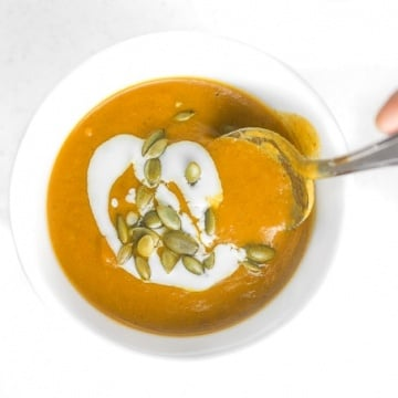 Coconut curry pumpkin soup is a bowl of comfort with a kick. This soup comes together in less than 30 minutes using a handful of ingredients! | aheadofthyme.com