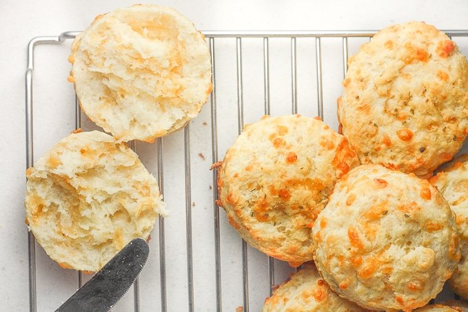 Garlic cheddar biscuits qualify as breakfast or a dinner side dish. These are packed with flavour and can be prepped for the oven in less than 15 minutes! | aheadofthyme.com