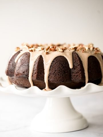 This showstopping festive gingerbread bundt cake with maple cinnamon glaze and pecans is moist, soft, and fluffy, and packed with warm holiday spices.   aheadofthyme.com
