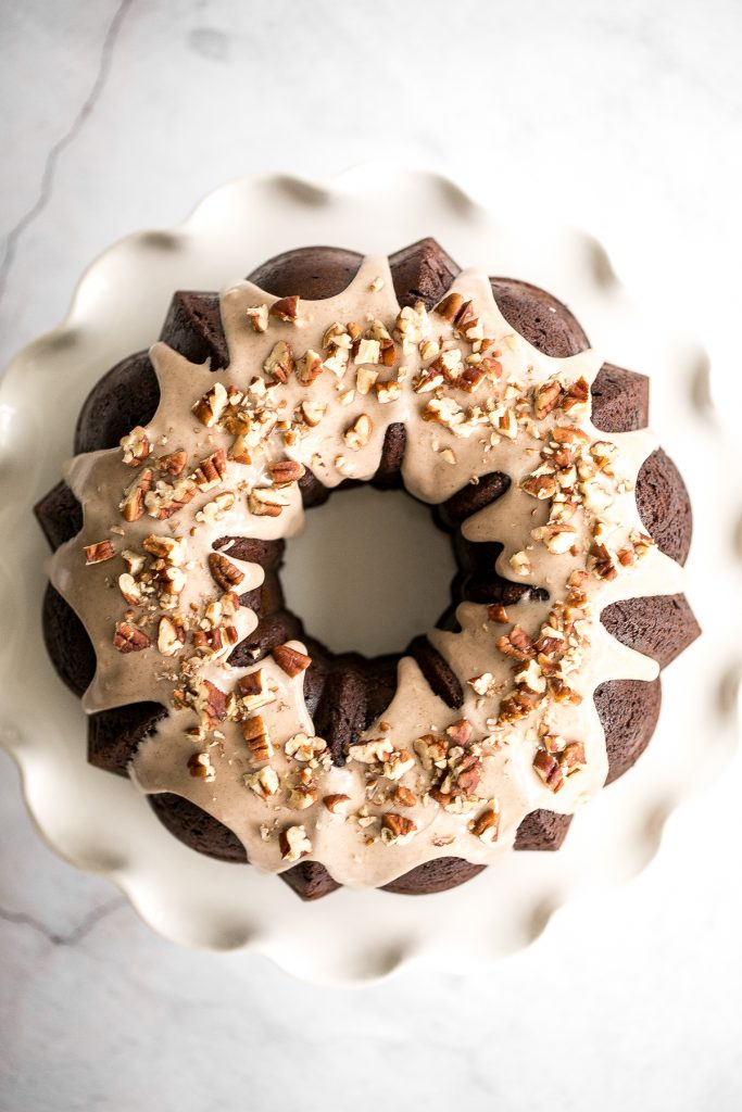 This showstopping festive gingerbread bundt cake with maple cinnamon glaze and pecans is moist, soft, and fluffy, and packed with warm holiday spices. | aheadofthyme.com