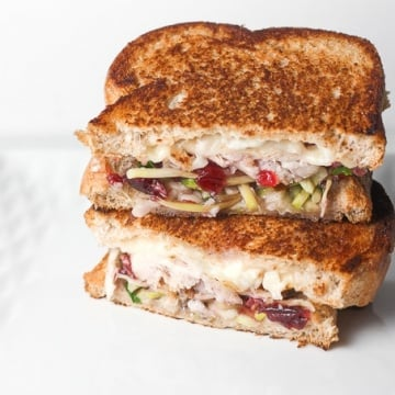 Looking for comfort food in a hand-held serving? Well, put those holiday leftovers to good use and make leftover Thanksgiving turkey sandwich with cranberry sauce! | aheadofthyme.com