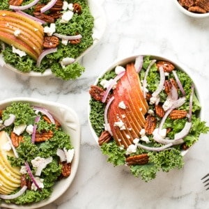 Cozy winter kale salad with apple cider vinaigrette is easy to make with crispy apples, tangy goat cheese and crunchy spiced pecans in under 10 minutes! | aheadofthyme.com