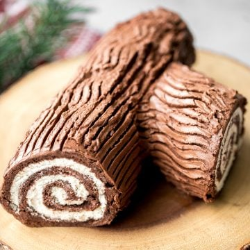 Holiday yule log cake (Bûche de Noël) with a chocolate sponge cake, whipped cream filling, and whipped chocolate ganache coating is a Christmas classic. | aheadofthyme.com