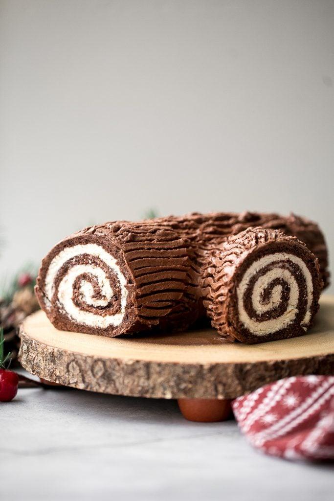 Holiday yule log cake (Bûche de Noël) with a chocolate sponge cake, whipped cream filling, and whipped chocolate ganache coating is a Christmas classic.   aheadofthyme.com