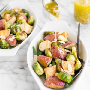 This roasted brussels sprouts salad with creamy potatoes, crispy string beans, and dijon vinaigrette makes for a delicious vegan meal this season! | aheadofthyme.com