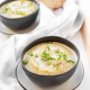 Say hello to cozy winter nights in with skinny creamy artichoke soup, bursting with the unique flavour and aroma of artichokes, leeks, and creamy potatoes. | aheadofthyme.com
