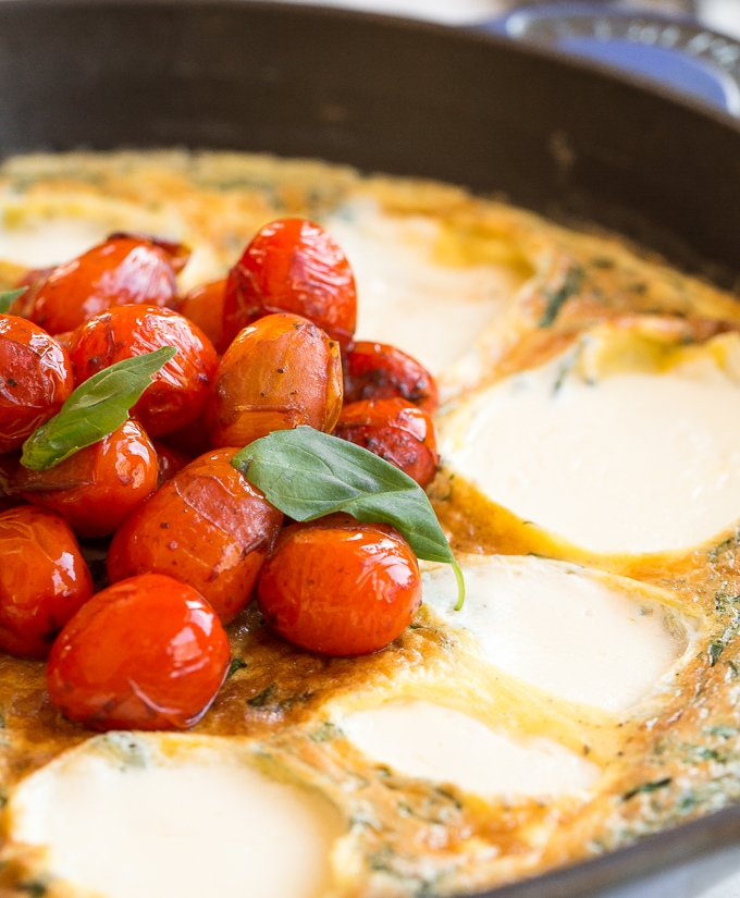 This 15-minute caprese frittata is the recipe you've been waiting for -- tomatoes, basil, fresh mozzarella wrapped between fluffy, light eggs. A go-to breakfast for entertaining or an easydinner for busy weeknights. | aheadofthyme.com