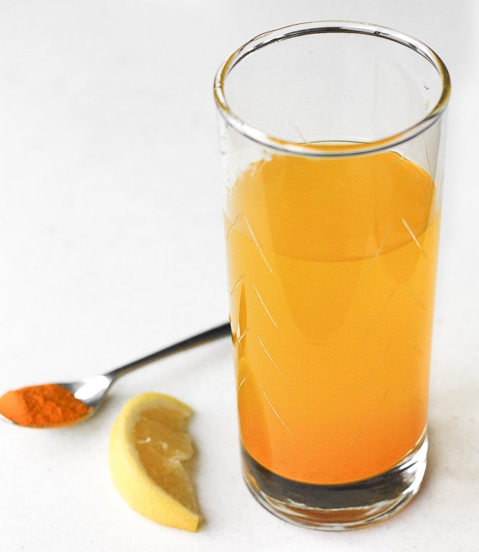 Start your mornings right with this easy-to-make, apple cider turmeric detox drink bursting with incredible health benefits. | aheadofthyme.com