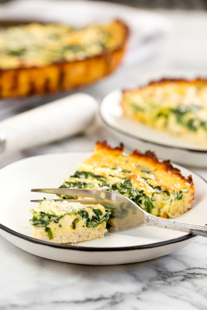 Spinach and feta quiche is healthy and gluten-free with a keto cauliflower crust and savoury vegetarian filling. Serve for breakfast, lunch or dinner. | aheadofthyme.com