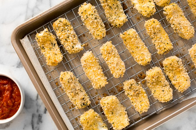 Crunchy, cheesy, and paired with an awesome dipping sauce, these baked mozzarella sticks are just as amazing as what you would find in a restaurant!   aheadofthyme.com