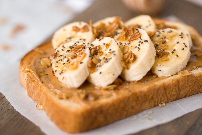 Breakfast routine in need of an upgrade? Banana toast with granola and honey is the perfect, protein-packed meal, and it is ready in literally 5 minutes! | aheadofthyme.com