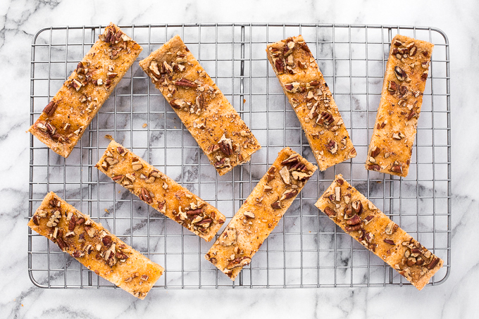 These pecan toffee bars combine the flavours of shortbread topped with crunchy nuts to create magic. Prepped in under 10 minutes with only 6 ingredients! | aheadofthyme.com
