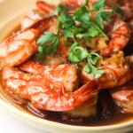 Perfectly cooked tiger prawns in garlic ginger soy sauce is juicy, tender and immersed in incredible Asian flavours. | aheadofthyme.com