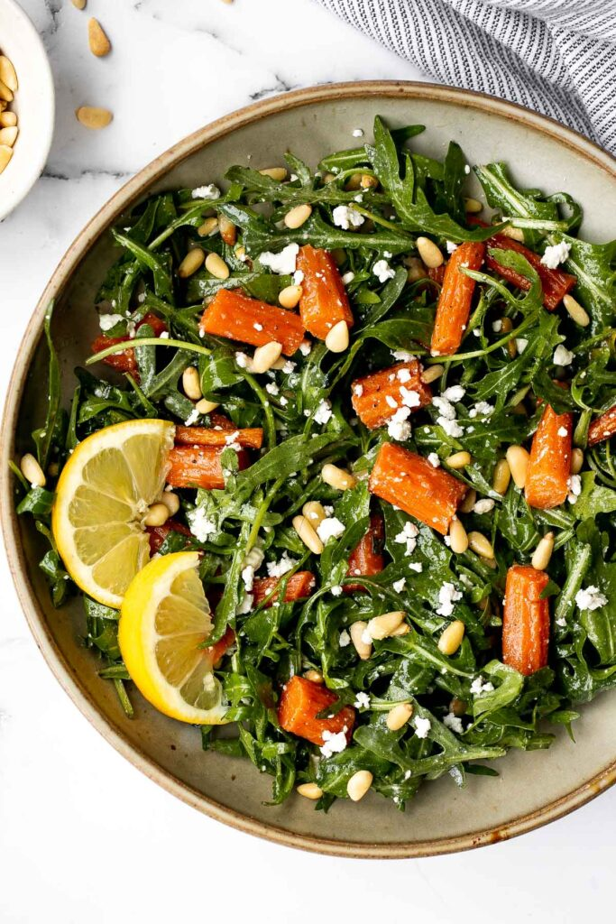 Arugula and roasted carrot salad is one of the best spring salads, packed with a delicious combination of sweet and sour flavours, plus easy to make.   aheadofthyme.com