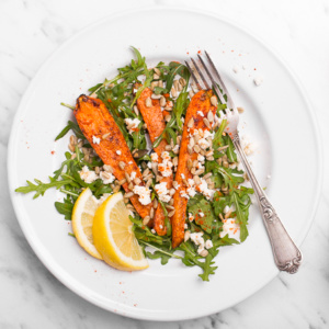 Delicious and stunning arugula and roasted carrot salad combines the delicious flavours of lemon juice, sweet carrots, creamy goat cheese, and spicy arugula. Plus, it's so easy to prepare! | aheadofthyme.com