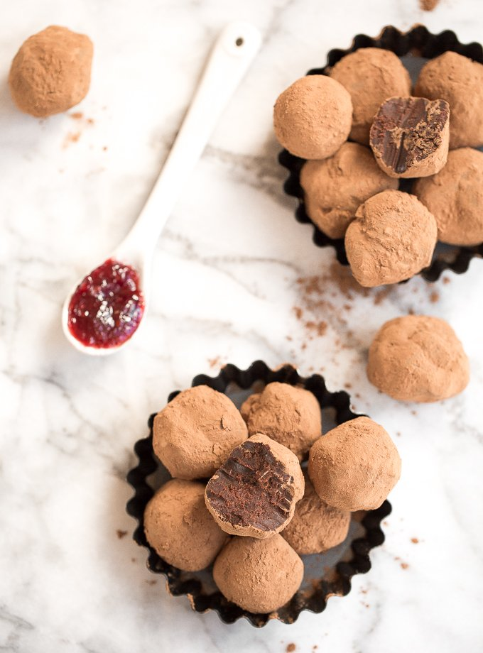 Dark chocolate raspberry truffles is so much easier to make than you might think! It is literally as simple as combining high quality chocolate, cocoa and raspberry jam. | aheadofthyme.com