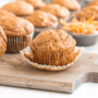 Are you a fan of carrot cake? Then you will be a fan of these warm, lightened up, spiced carrot muffins which will satisfy even your strongest cravings! | aheadofthyme.com