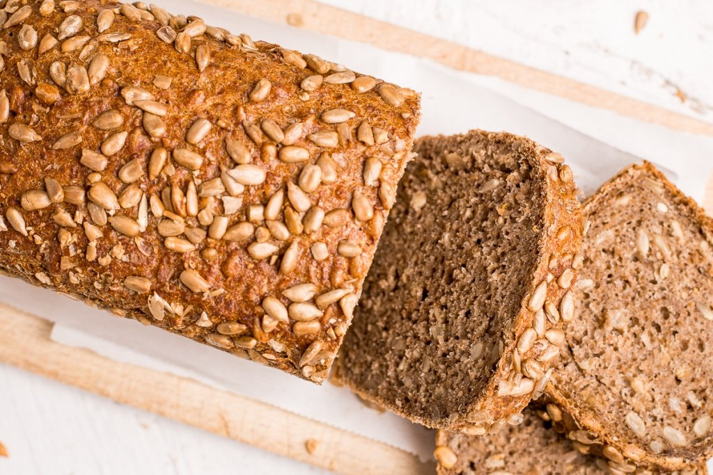 Learn how to make a delicious, golden brown loaf of homemade sunflower seed bread today! It is soft and fluffy on the inside, and crispy on the outside. | aheadofthyme.com