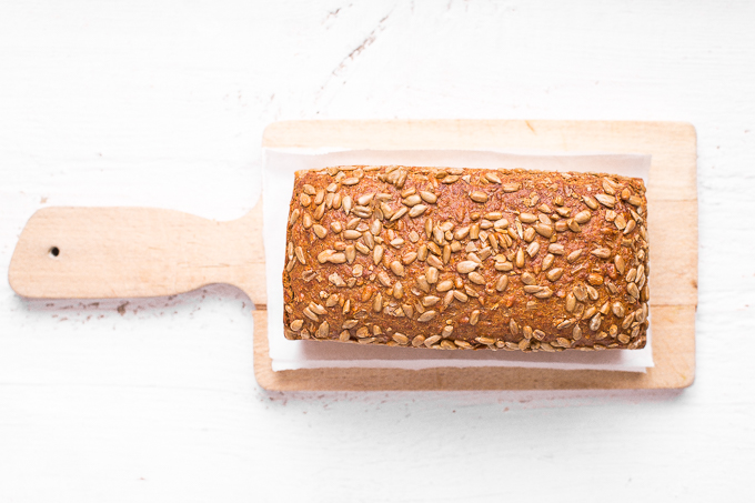 Delicious, golden brown loaf of homemade sunflower seed bread is soft and fluffy on the inside, and crispy on the outside. There are not too many things better than the smell and taste of freshly baked bread enjoyed in the comfort of your own home! | aheadofthyme.com