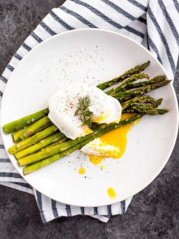 Roasted asparagus with poached eggs and fresh herbs is a classy, elevated spring meal that will leave you feeling light, but completely satisfied. | aheadofthyme.com