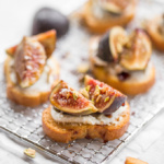 This crostini topped with sweet, juicy figs and paired with tangy goat cheese and crunchy pistachios is so flavourful and perfect for snacking on or entertaining. | aheadofthyme.com