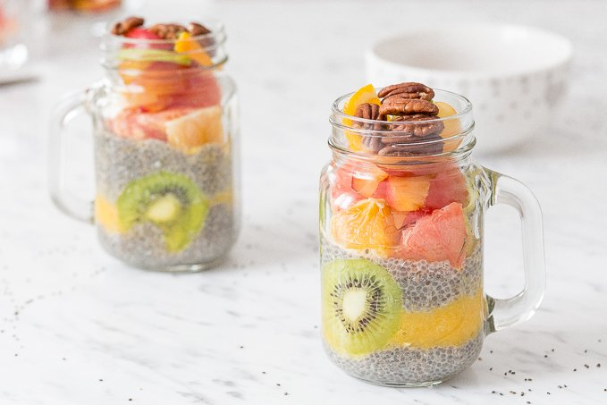 Jump on the chia seed craze with this delicious, gluten-free and vegan fruit layered chia seed pudding! It's the perfect healthy breakfast or dessert, and is full of protein, fiber and antioxidants, so you won't feel guilty having seconds! | AHEADOFTHYME.COM