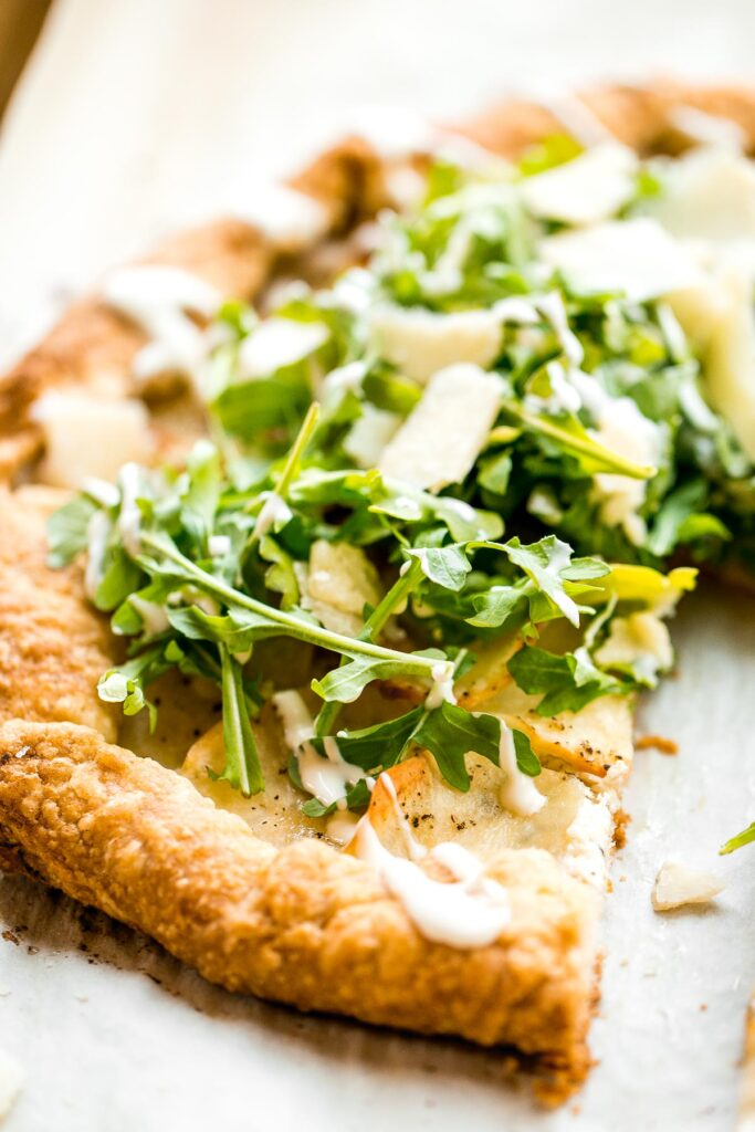 Potato galette with arugula and crème fraîche is a rich, light, and delicious savoury tart to serve for breakfast, lunch, or dinner. A total crowd-pleaser. | aheadofthyme.com