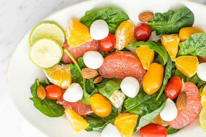 This summer citrus salad is packed with a refreshing combination of flavours... zingy grapefruit, sweet orange, soft mozzarella and crunchy almonds – all in one bowl!   aheadofthyme.com