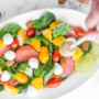 This summer citrus salad is packed with a refreshing combination of flavours... zingy grapefruit, sweet orange, soft mozzarella and crunchy almonds – all in one bowl! | aheadofthyme.com