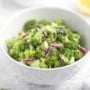 Creamy raw broccoli slaw is a healthy, vegetable-forward dish that is packed with so much flavour from the homemade creamy dressing, salty feta, and lots of sweet raisins — you will be shocked that it's actually good for you! | aheadofthyme.com