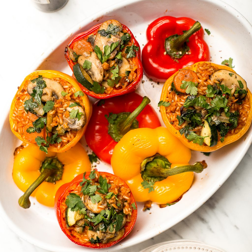 Easy vegan stuffed bell peppers are filled with brown rice, mushrooms, veggies, and seasonings, then baked for 40 minutes. It's a perfect weeknight dinner. | aheadofthyme.com