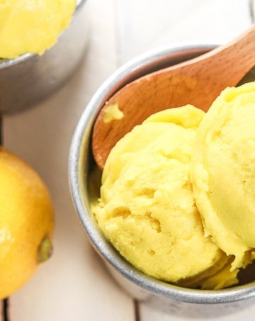Grab a few easy ingredients, throw them in the blender and in a fews hours, a refreshing and unbelievably healthy lemon turmeric sorbet will be all set and ready for digging in!! | aheadofthyme.com