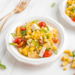 Take fresh-off-the-grill corn on the cob and turn it into a light, flavourful summer corn salad, topped with tomatoes, scallions and cheese. This is the side dish your cookouts have been missing! | aheadofthyme.com