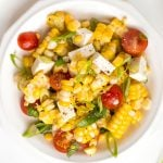 Take fresh-off-the-grill corn on the cob and turn it into a light, flavourful summer corn salad, topped with cherry tomatoes, fresh basil and cheese. | aheadofthyme.com