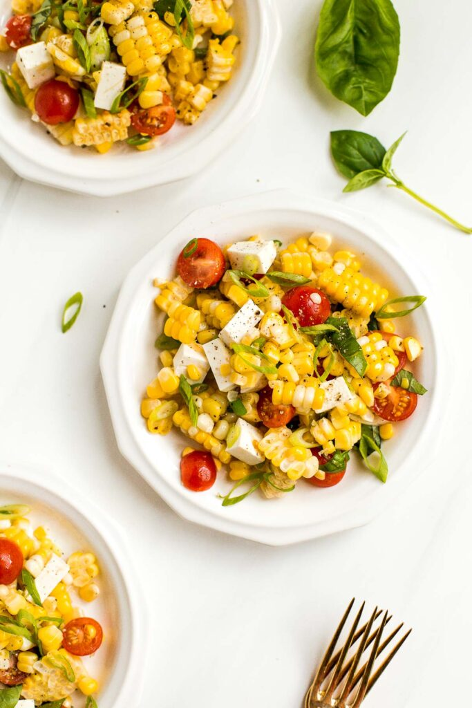 Take fresh-off-the-grill corn on the cob and turn it into a light, flavourful summer corn salad, topped with cherry tomatoes, fresh basil and cheese.   aheadofthyme.com