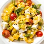 Summer corn salad is loaded to the brim with grilled corn, sweet cherry tomatoes, ricotta salata cheese, and fresh basil for that signature summer taste.| aheadofthyme.com