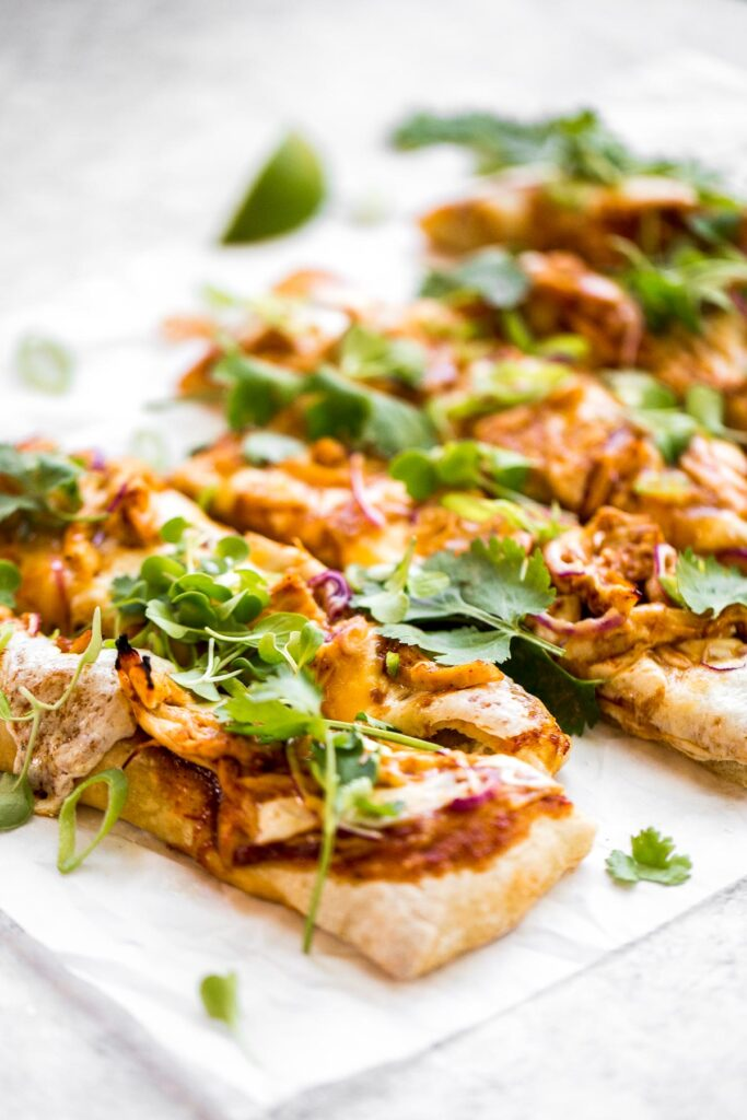 Forget delivery and make sweet, tangy, and smoky BBQ chicken pizza from the comfort of your own home in under 30 minutes. The easiest weeknight dinner.   aheadofthyme.com
