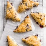 Light, tender and flakey, glazed lemon blueberry scones are crunchy and golden on the outside, soft and moist in the middle, with a drizzle of lemon glaze. | aheadofthyme.com