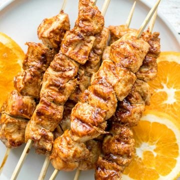 Flame-kissed, sticky and saucy, grilled orange chicken skewers with a rich, citrus-based marinade are delicious, juicy and so tender. Best weeknight dinner. | aheadofthyme.com
