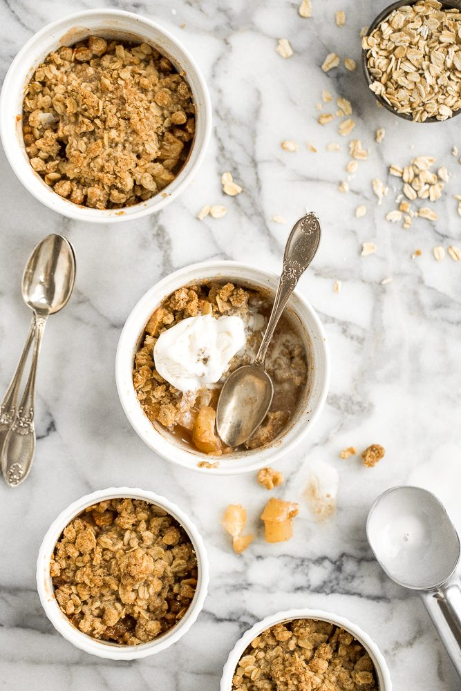 Individual apple crisp are served in ramekins so that you and your guests can enjoy single-sized servings meaning you will get the crunchy corners of crumble all to yourselves! | aheadofthyme.com