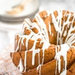 Celebrate fall this year with think and dense, yet surprisingly light, pumpkin pie bundt cake with cream cheese glaze. Can you think of a more perfect pair? | aheadofthyme.com