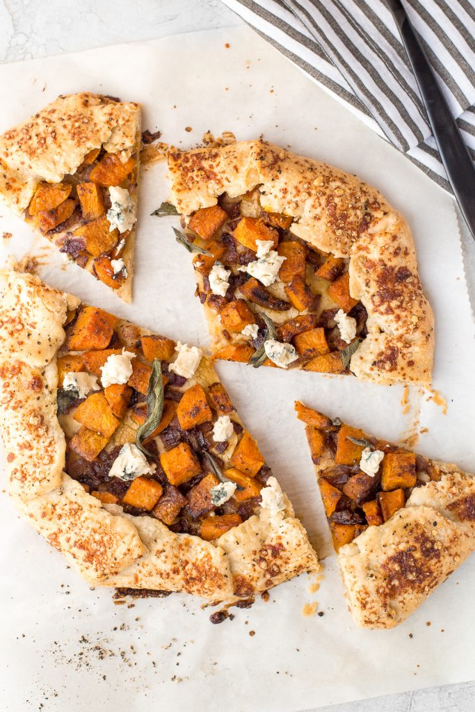 This butternut squash galette (free-form tart) is the perfect meal any time of day! Serve it with a fried egg for breakfast or alongside a big salad for lunch or dinner. | aheadofthyme.com