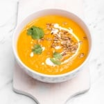 Bursting with flavor, this comforting, vegetarian carrot pumpkin soup is wholesome, nutritious and perfect to feed a whole family on a lazy night. | aheadofthyme.com