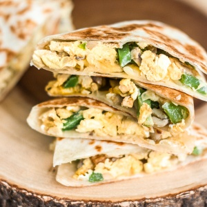 Make-ahead, freezer-friendly vegetarian breakfast quesadillas stuffed with eggs, onions, green peppers, mushrooms, and sharp white cheddar, are grilled to crispy perfection. Eat them now or freeze for a later day! | aheadofthyme.com