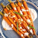 These maple roasted carrots with yogurt sauce are not only stunning, but they get all caramelized and crispy around the sides from the maple syrup... pure perfection! | aheadofthyme.com