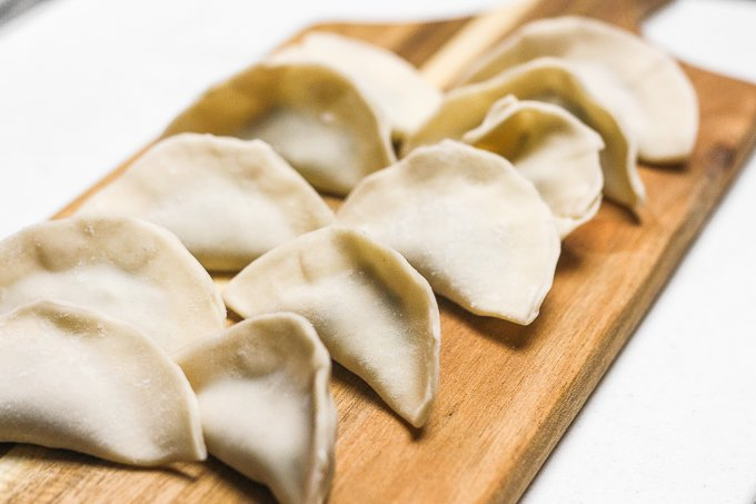Easy-to-make Chinese beef dumplings with celery can be made in advance for a stress-free meal. Enjoy these steamed, boiled or pan-fried! | aheadofthyme.com