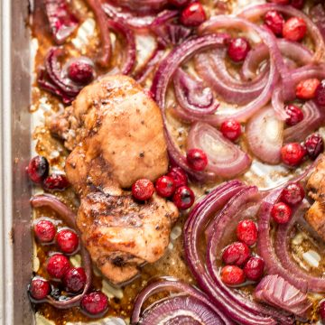 Roasted balsamic chicken with cranberries is a quick and easy 30-minute weeknight dinner made with tender chicken thighs in a sweet and tangy marinade.   aheadofthyme.com