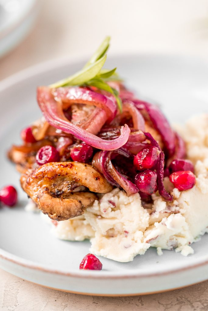 Roasted balsamic chicken with cranberries is a quick and easy 30-minute weeknight dinner made with tender chicken thighs in a sweet and tangy marinade. | aheadofthyme.com